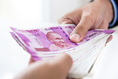 istock Businessman paying money, Indian Rupee currency, for the business investment 987130292