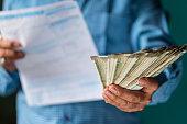 istock Businessman Paying Various Bills 1171982741