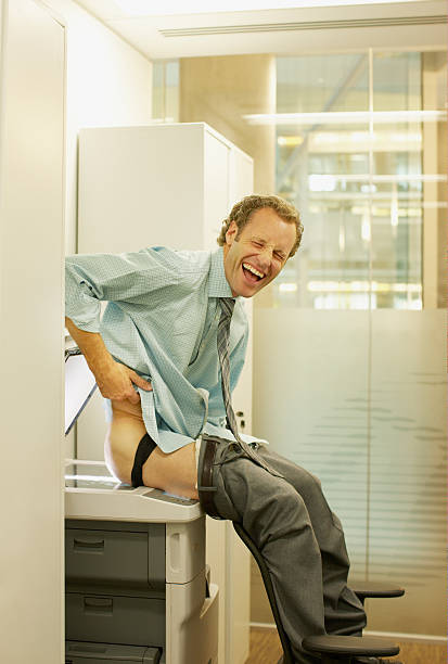 Businessman photocopying his buttocks stock photo