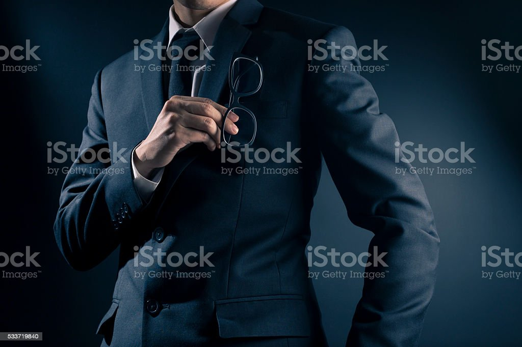 Businessman Pick Glasses: Isolated Black Background stock photo