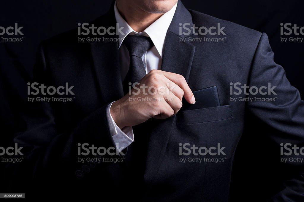 Businessman Pick Smartphone: Isolated Black Background stock photo