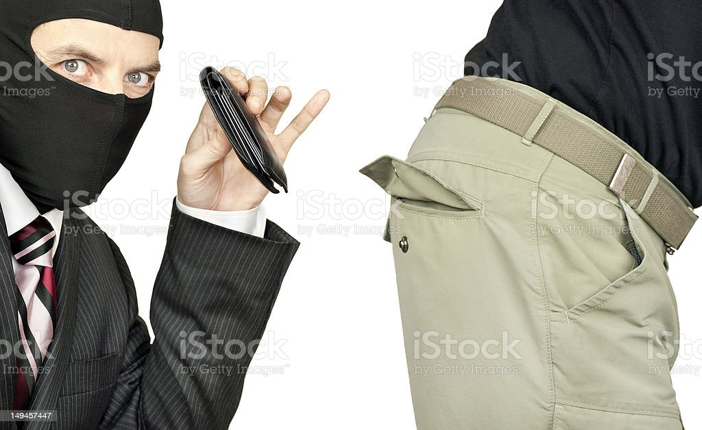 Businessman Picking Pocket Of Middle Class Man stock photo