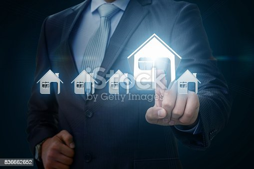 1023041738istockphoto Businessman picks a house . 836662652