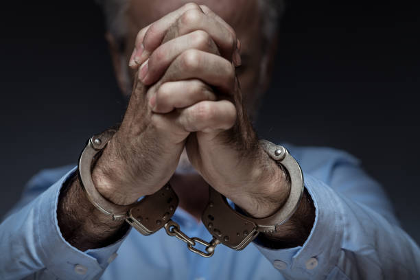 Businessman Portrait of businessman in handcuffs arrest stock pictures, royalty-free photos & images