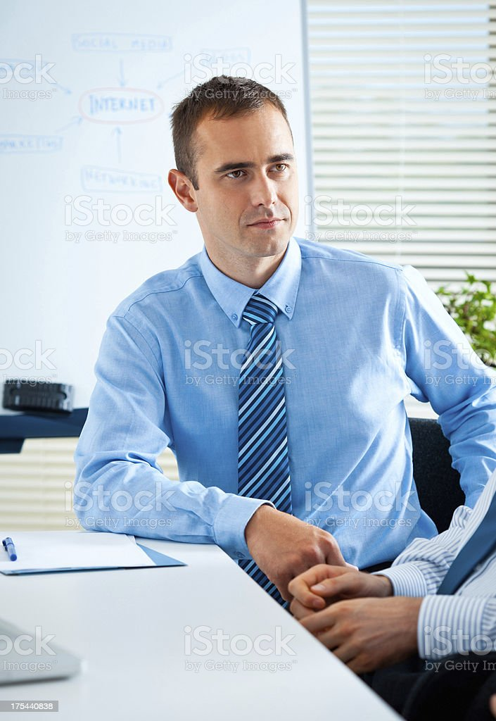 Businessman Businessman taking part in a business meeting in board room. 35-39 Years Stock Photo