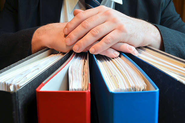 Businessman Businessman with file folders civil servant stock pictures, royalty-free photos & images