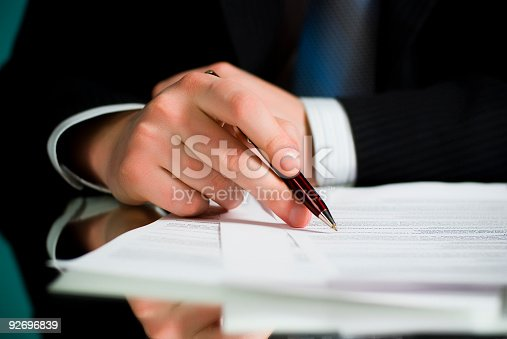 Businessman is signing contracts