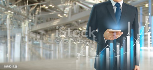 istock Businessman plan graph growth  increase of chart positive indicators in his business.smartphone in hand 1187501728