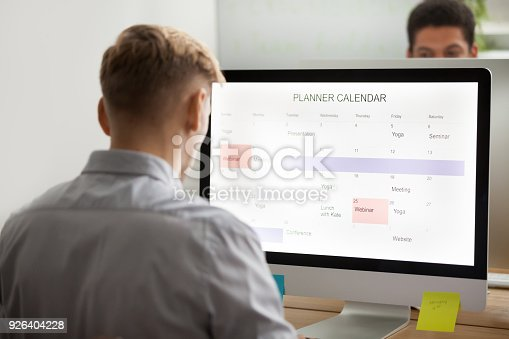 istock Businessman planning making schedule on computer planner application, time management 926404228