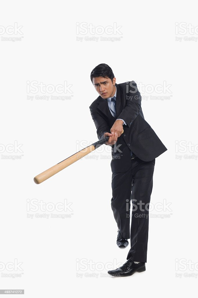 Businessman playing baseball stock photo