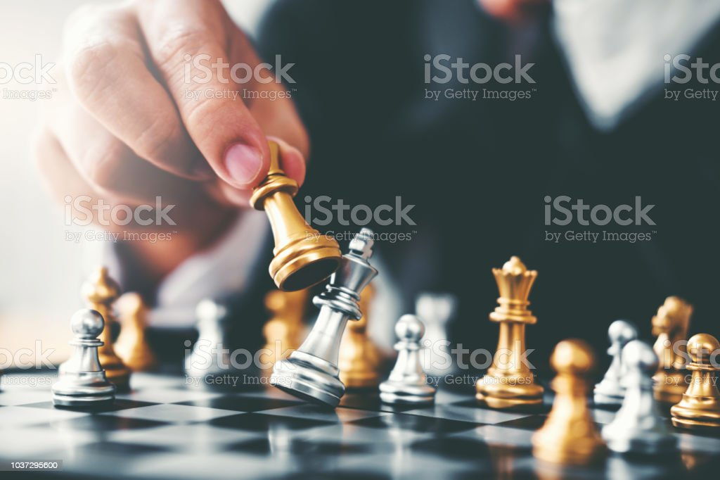 Businessman playing chess game Planning of leading strategy...