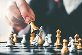 istock Businessman playing chess game Planning of leading strategy successful business leader concept 1037295600