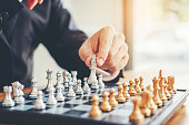 istock Businessman playing chess game Planning of leading strategy successful business leader concept 1037295774