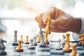 istock Businessman playing chess game Planning of leading strategy successful business leader concept 1037295820