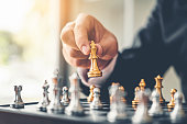 istock Businessman playing chess game Planning of leading strategy successful business leader concept 1049123320