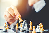 istock Businessman playing chess game Planning of leading strategy successful business leader concept 1056564508
