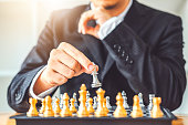istock Businessman playing chess game Planning of leading strategy successful business leader concept 1056564532