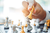 istock Businessman playing chess game Planning of leading strategy successful business leader concept 1062332330