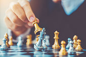 istock Businessman playing chess game Planning of leading strategy successful business leader concept 1065346274