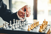 istock Businessman playing chess game Planning of leading strategy successful business leader concept 1065346276