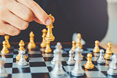 istock Businessman playing chess game Planning of leading strategy successful business leader concept 1065346282