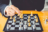 istock Businessman playing chess game Planning of leading strategy successful business leader concept 1065346292