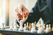 istock Businessman playing chess game Planning of leading strategy successful business leader concept 1089938554