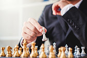 istock Businessman playing chess game Planning of leading strategy successful business leader concept 1126576184