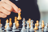 istock Businessman playing chess game Planning of leading strategy successful business leader concept 1126576191