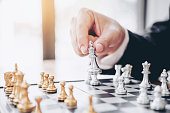 istock Businessman playing chess game Planning of leading strategy successful business leader concept 1126576228