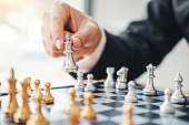 istock Businessman playing chess game Planning of leading strategy successful business leader concept 1145151282
