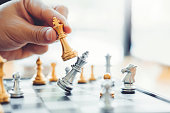 istock Businessman playing chess game Planning of leading strategy successful business leader concept 1145151299
