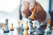 istock Businessman playing chess game Planning of leading strategy successful business leader concept 1160539643