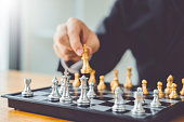 istock Businessman playing chess game Planning of leading strategy successful business leader concept 1160539821