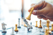 istock Businessman playing chess game Planning of leading strategy successful business leader concept 1169928932