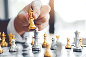 istock Businessman playing chess game Planning of leading strategy successful business leader concept 1169929331