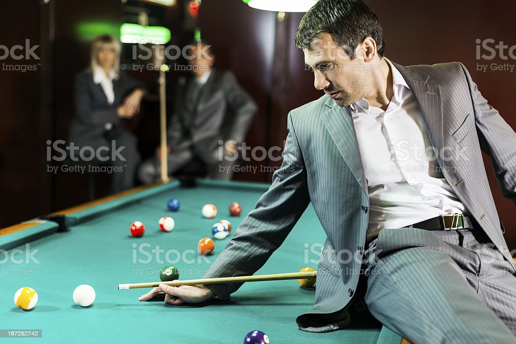 Businessman playing snooker. stock photo
