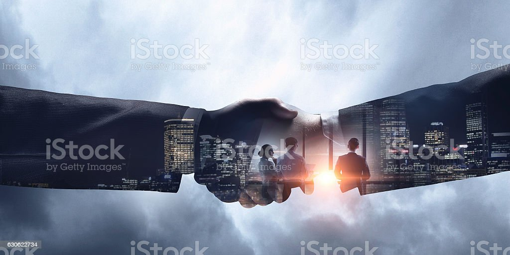 Businessman playing soccer . Mixed media stock photo