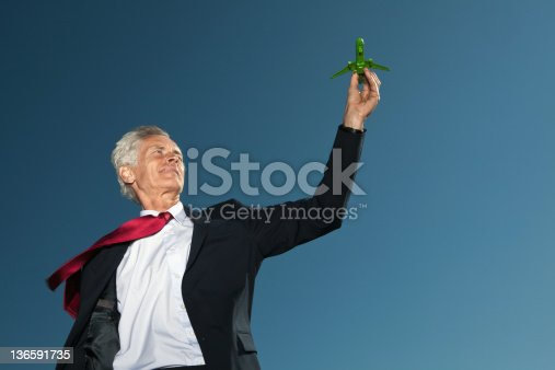 istock Businessman playing with airplane 136591735