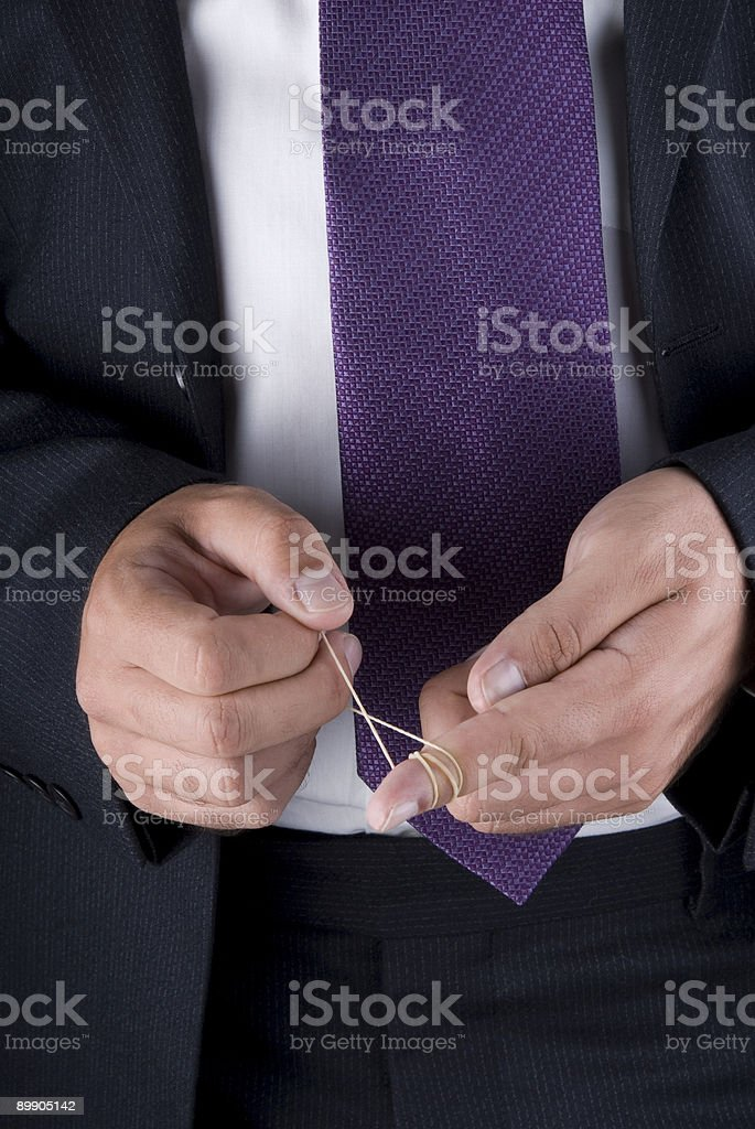 Businessman playing with rubber in his hand royalty-free stock photo
