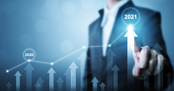 Businessman pointing arrow graph corporate future growth plan. Business development to success and growing growth year 2020 to 2021 concept