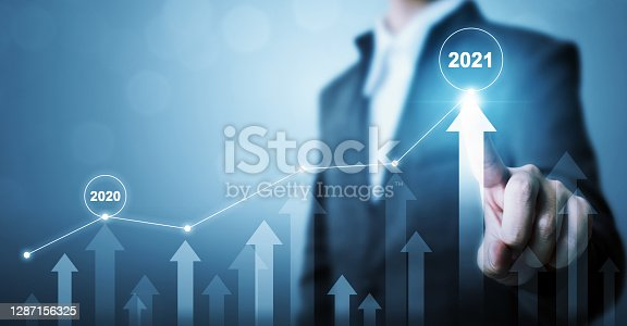 istock Businessman pointing arrow graph corporate future growth plan. Business development to success and growing growth year 2020 to 2021 concept 1287156325