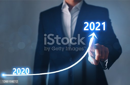 Businessman pointing arrow graph corporate future growth year 2020 to 2021. Development to success and growing growth concept