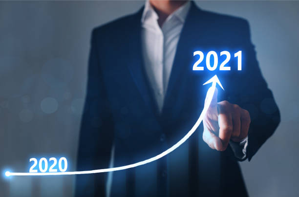 Businessman pointing arrow graph corporate future growth year 2020 to 2021. Development to success and growing growth concept. Businessman pointing arrow graph corporate future growth year 2020 to 2021. Development to success and growing growth concept cheap stock pictures, royalty-free photos & images