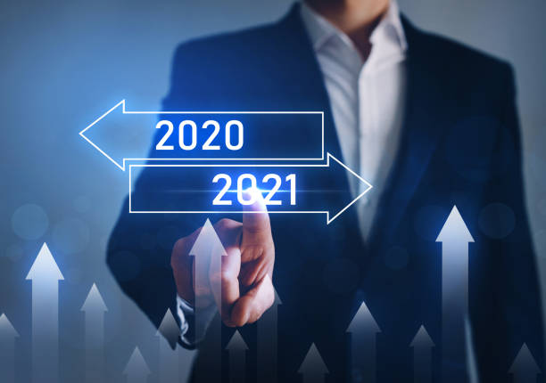 Businessman pointing arrow graph corporate future growth year 2020 to 2021. Development to success and growing growth concept. stock photo