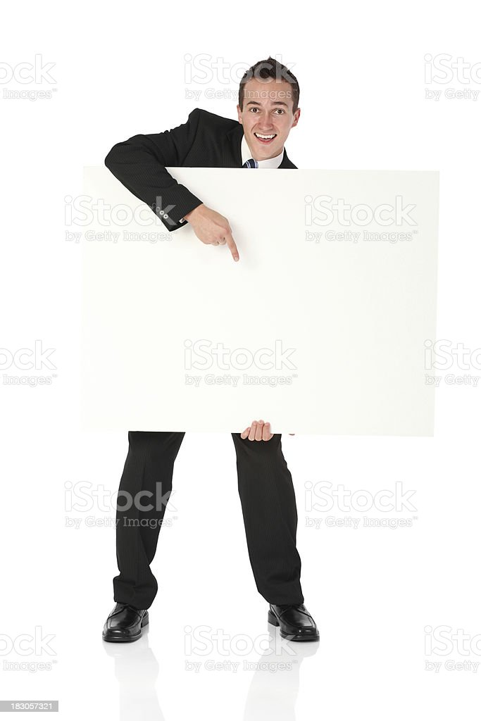 Businessman pointing at a blank placard royalty-free stock photo