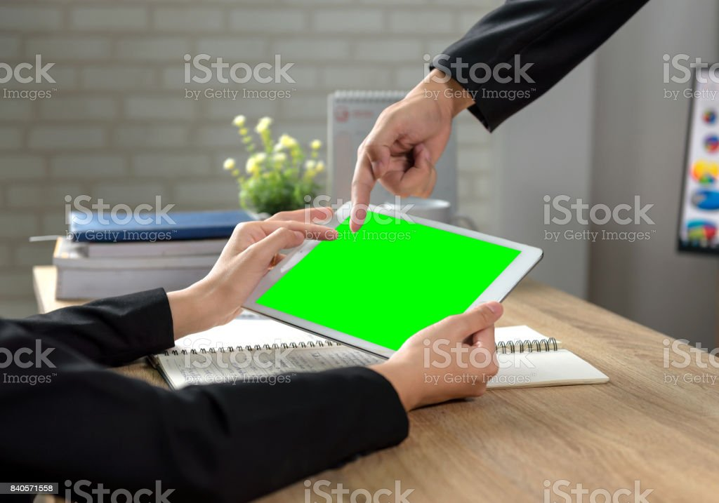 Businessman pointing at a touch screen working at a meeting.
