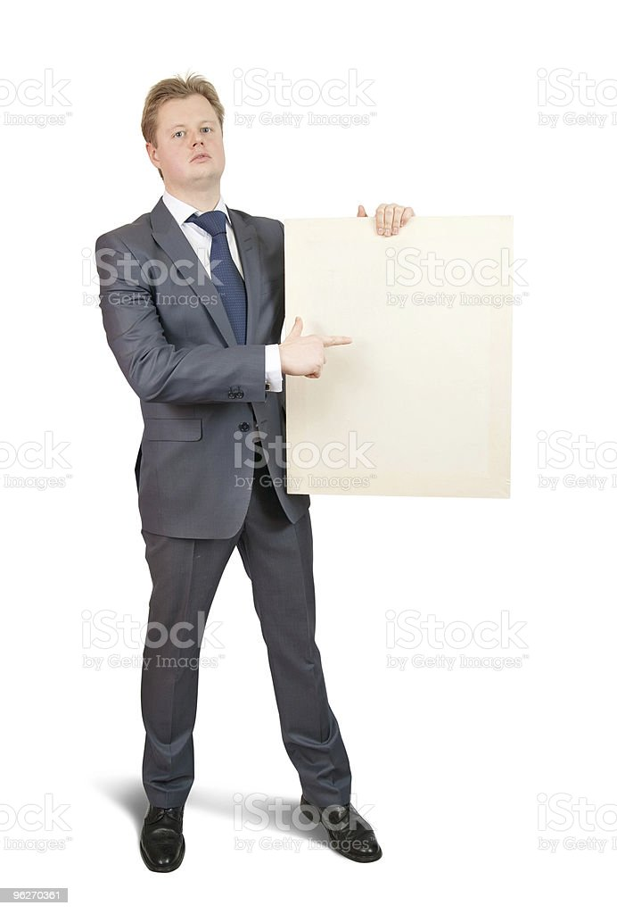 Businessman  pointing at blank canvas royalty-free stock photo