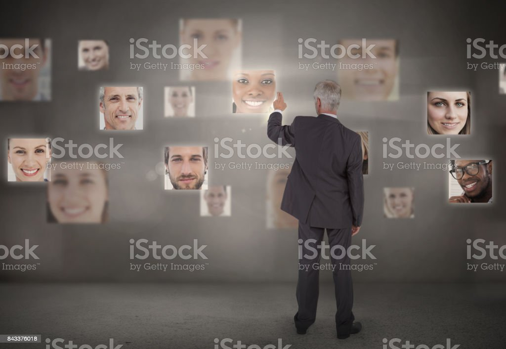 Businessman pointing at digital interface stock photo