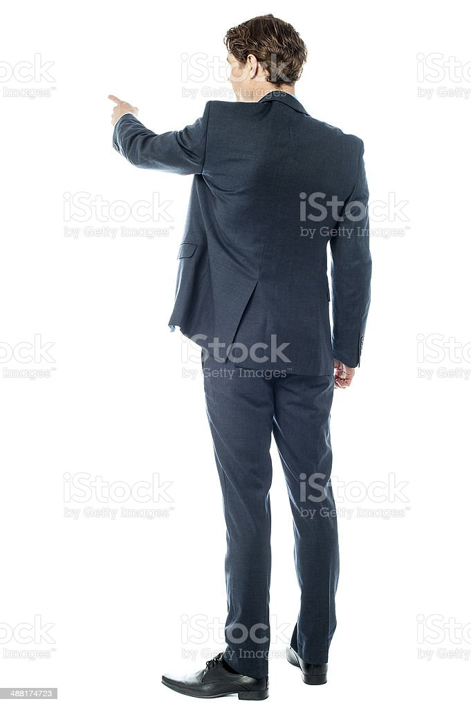 Businessman pointing at something royalty-free stock photo